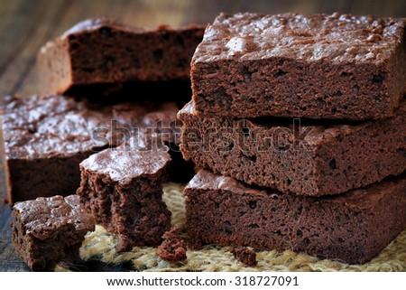 Stack of homemade chocolate brownies bars closeup - stock photo