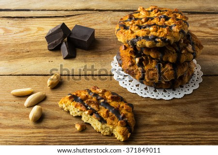Stack of Homemade chocolate peanut cookies on a rustic wooden table, close up. Cookies. Pastry. Biscuits. Homemade cookies   - stock photo