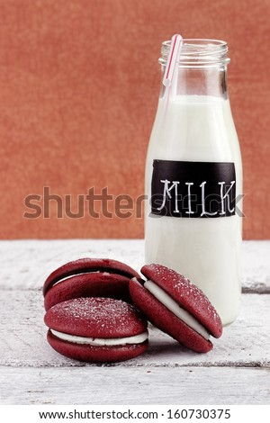 Stack of homemade Red Velvet Whoopie Pies or Moon Pies made with cream cheese frosting.  - stock photo