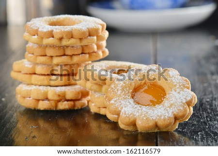 Stack of homemade sweet biscuit cookies with jam - stock photo