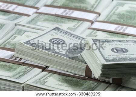 Stack of hundred dollar bills - stock photo