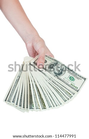Stack of hundred dollar bills in hand - stock photo