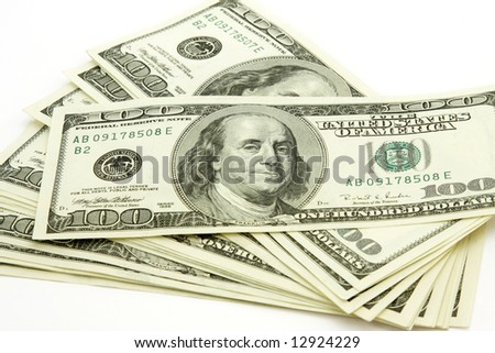 Stack of hundred dollar bills isolated on white