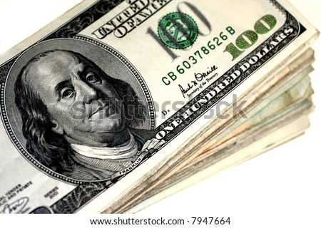 Stack of hundred dollar bills on white background.