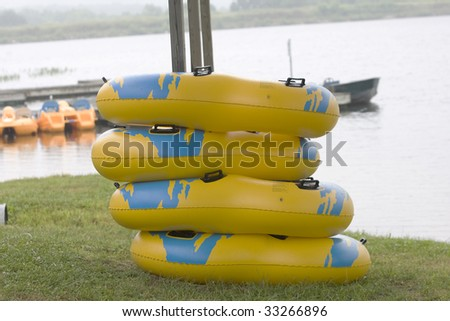 Stack of inflatable rings for fun - stock photo