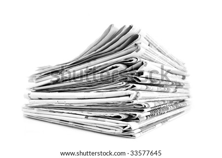 Stack of isolated newspapers in black and white - stock photo