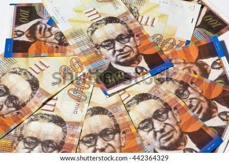 Stack of Israeli money bills of 100 shekel - top view. - stock photo