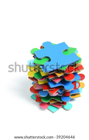 Stack of Jigsaw Puzzle Pieces on White Background - stock photo
