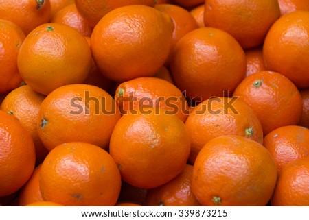 Stack of juicy ripe orange fruit - stock photo