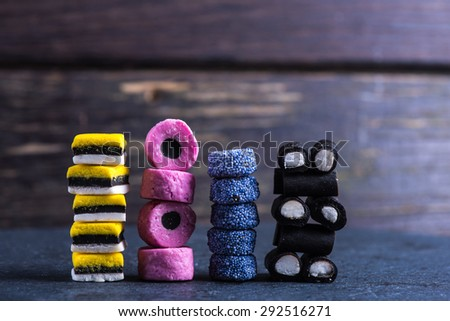stack of Liquorice candy, mixed colors vibrant background - stock photo