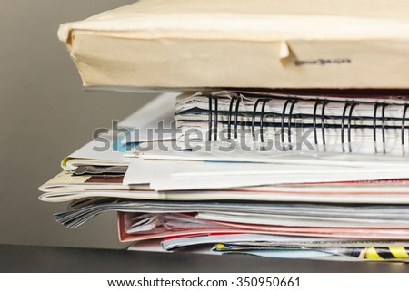 Stack of magazines and papers in room