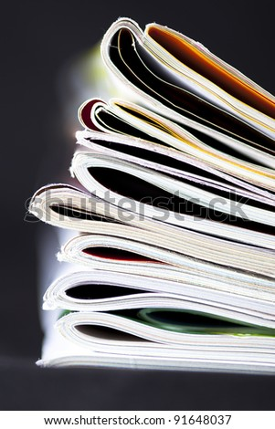 stack of magazines isolated on black