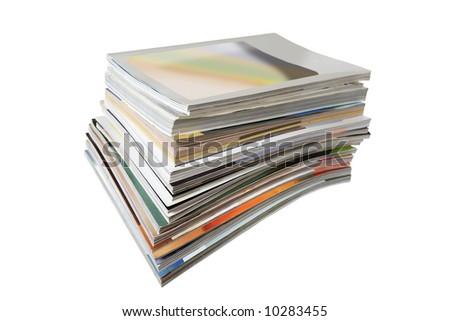 Stack of magazines isolated on white - stock photo