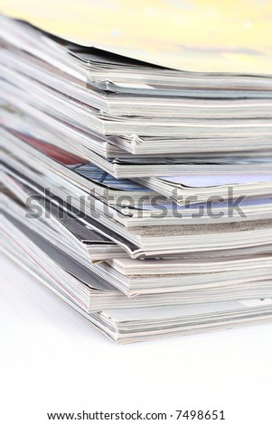 stack of magazines isolated on white