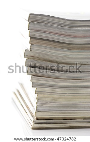 Stack of magazines isolated on white background.