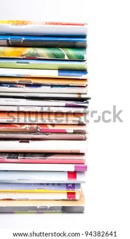 Stack of magazines isolated on white background - stock photo