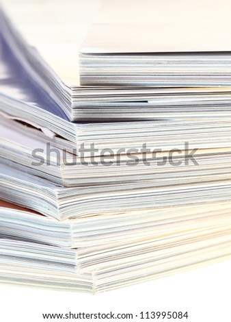 stack of magazines isolated over white background