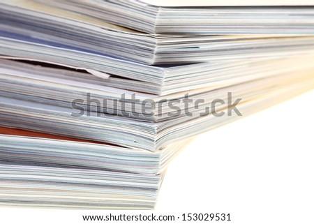 stack of magazines isolated over white background - stock photo