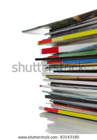 stack of magazines isolated over white background - stock photo