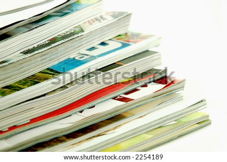 Stack of magazines on an isolated background - stock photo