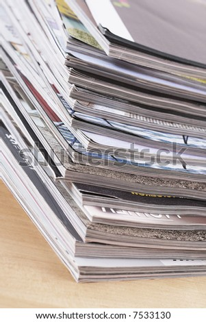 stack of magazines on the table - close-ups