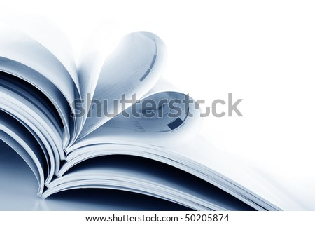 stack of magazines on the white background - stock photo