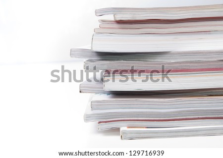 Stack of magazines on white - stock photo