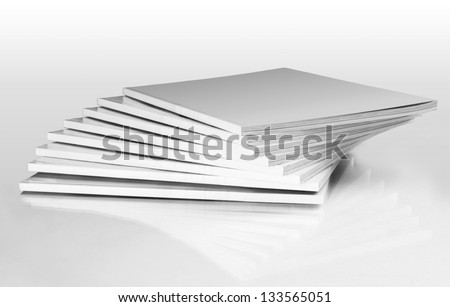 Stack of magazines with a blank cover, isolated on white - stock photo