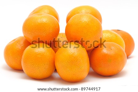 Stack of mandarines placed on the white background. - stock photo