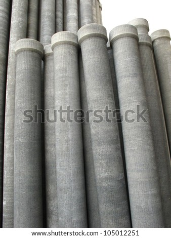 Stack of many asbestos pipes on white background - stock photo