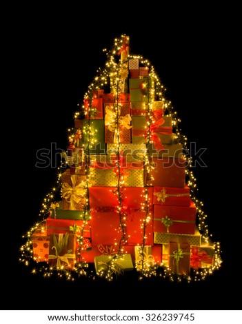 Stack of many christmas presents illuminated like a christmas tree - stock photo