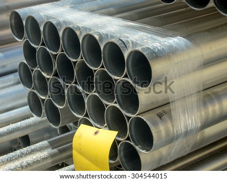 Stack of many pipes at the construction site. - stock photo