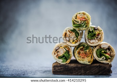 stack of mexican street food fajita wrap, copy space for text - stock photo