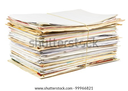 Stack of mixed waste paper isolated on a white background