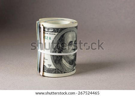 stack of money dollars bounded by rubber band. Vintage dollar background - stock photo