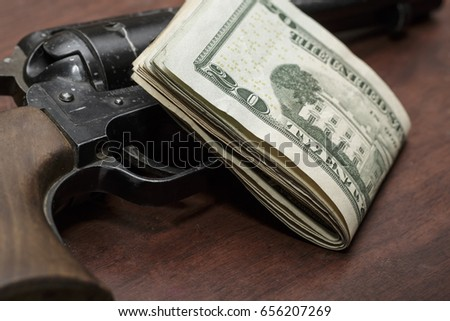 stack of money on a revolver