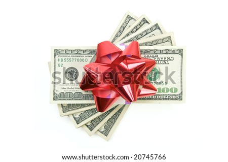 Stack of Money with Bow Isolated on a White Background. - stock photo