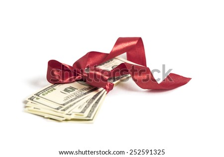 Stack of money with red ribbon  - stock photo