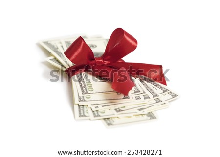 Stack of money with red ribbon