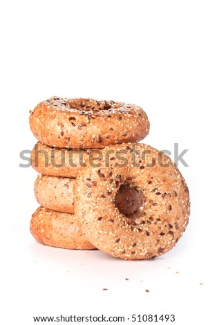 Stack of multi-seeded bagels with focus on the front one - stock photo