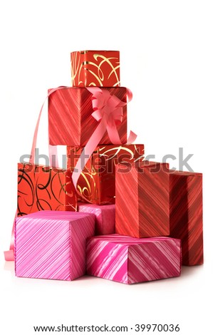 Stack of multicolored gifts on white background. - stock photo