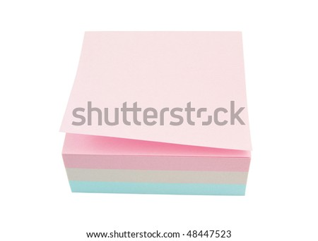 Stack of multicolored notes on white background