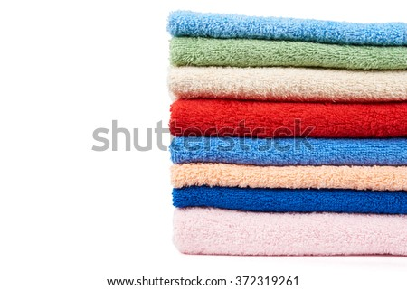 Stack of multicolored terry towels isolated on white - stock photo