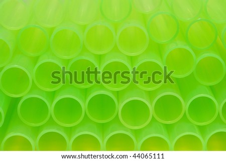 Stack of neon green laboratory plastic test tubes ready for an experiment  in a science research lab - stock photo