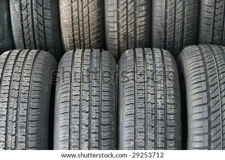 Stack of new tires in a shop ready to sell - stock photo