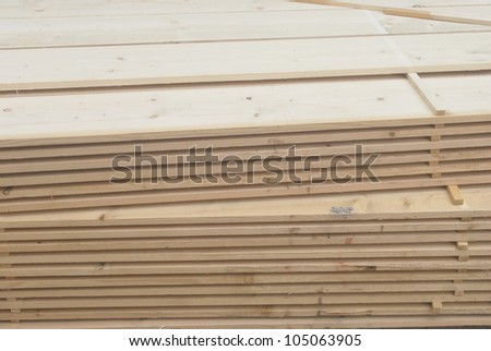Stack of new wood - stock photo
