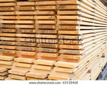 Stack of new wooden studs at a lumber yard - stock photo