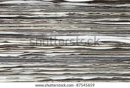 Stack of newspaper for background - stock photo