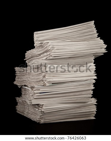 Stack of Newspaper on black background - stock photo