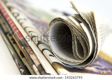 Stack of newspaper shallow depth of field - stock photo